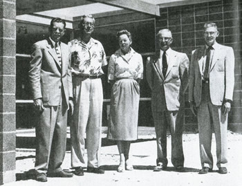 """The PSHS 1957 """"Chia"""" yearbook featured this photo of the board of education standing in front of the """"newly constructed"""" administration building. From left to right are President Ray Sorum, Mr. Arnold Rumwell, Mrs. Helen Staley, Mr. Haig Harris, and Mr. Frank Muller. Courtesy Palm Springs Historical Society"""