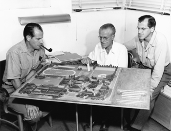 Harry, Roger and E. Stewart Williams study an architectural model of the PSHS campus during the late 1950s. The firm of Williams, Williams & Williams was in charge of the master plan for the complex. Courtesy Palm Springs Historical Society